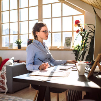 What is a hybrid workplace: woman continues to work from home while other team members work from the office.